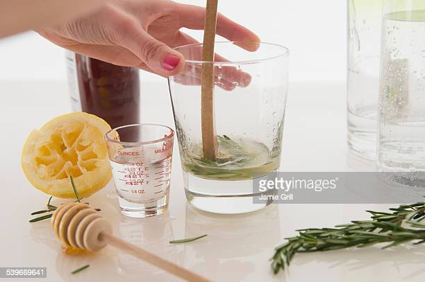 Woman making cocktail