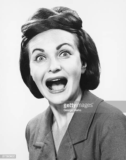 Woman making face, (B&W), portrait