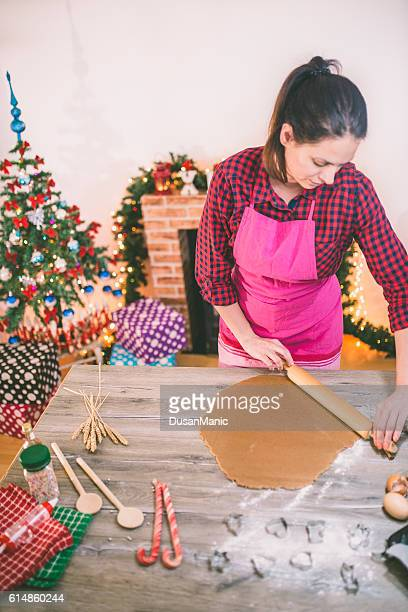 woman making gingerbread and cookies