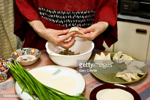 Woman making gyoza : Stock Photo