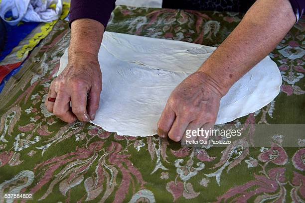 Woman making gözleme pies at Gölyazı town of Turkey