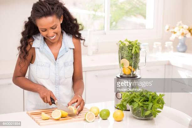 Woman making lemonade.