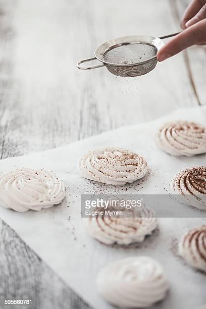 Woman making meringues