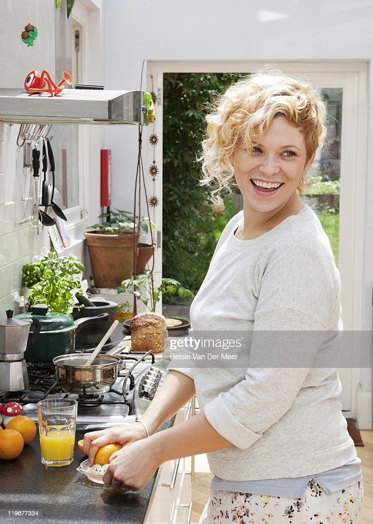 woman making orangejuice for breakfast. : Stock Photo