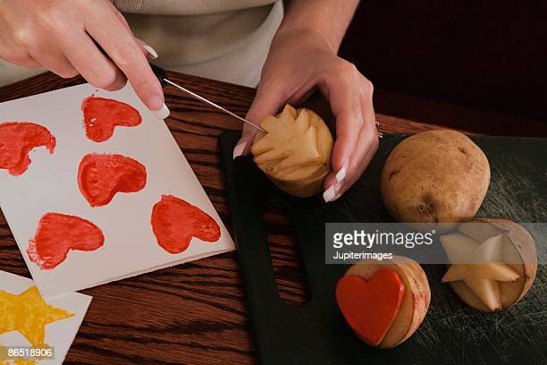 Woman making potato stamps