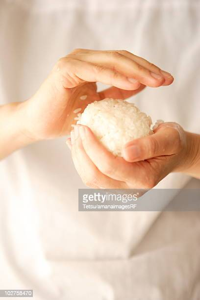 Woman making rice ball (Onigiri)