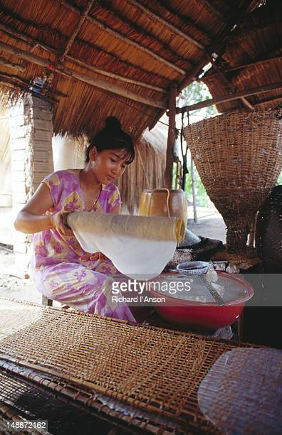 Woman making rice paper sheets for rice paper rolls, village of My Hanh Bac, near Ho Chi Minh City.