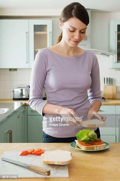 Woman making sandwich