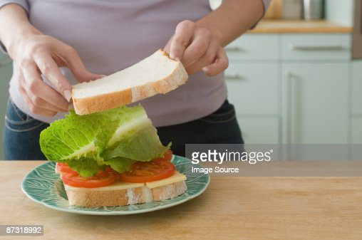 woman making sandwich stock photo getty images