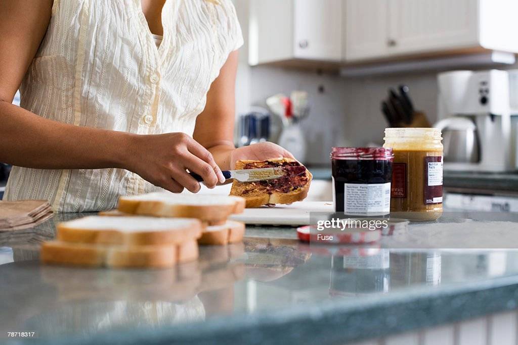 Woman Making Sandwiches