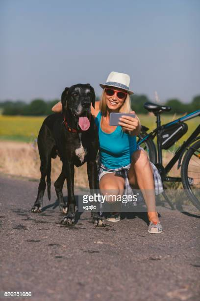 Woman making selfie with her dog