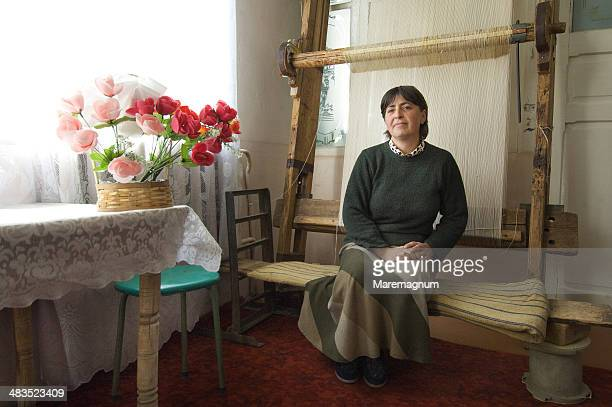 Woman making traditional carpets