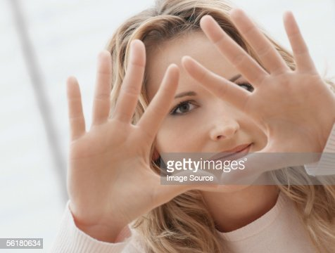 Woman making triangle shape with her hands
