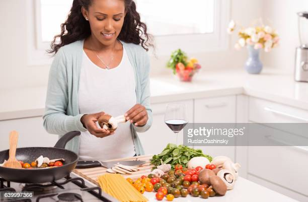 Woman making vegetarian dinner.