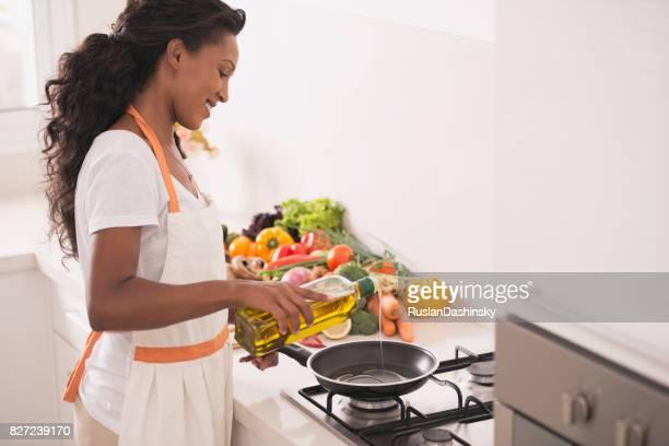 Woman making vegetarian dinner.