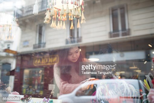 Woman making window display