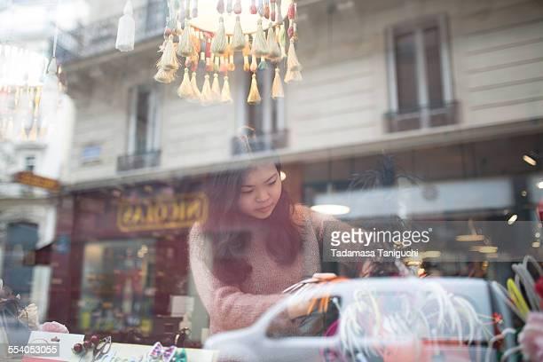 Woman making window display