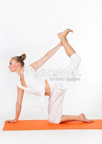 Woman Making Yoga Figure Stock Photo   Thinkstock