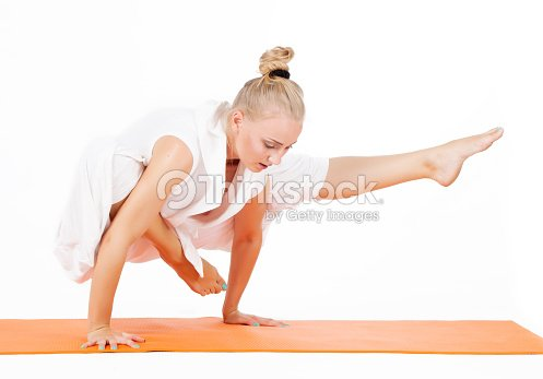 Woman Making Yoga Figure Stock Photo | Thinkstock