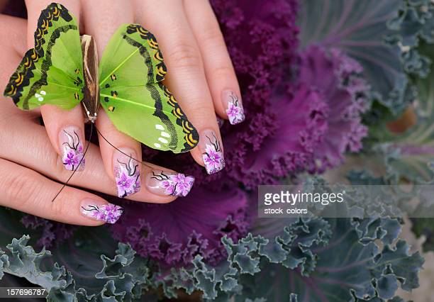 woman manicure and butterfly