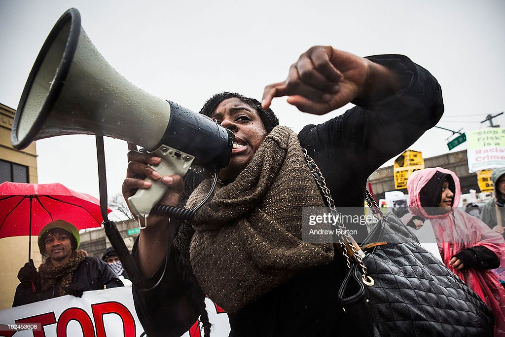 A woman marches against police stop-and-frisk tactics on February 23, 2013 in New York City. The march, which consisted of a few hundred people, started in the Bronx borough of New York and marched into the Harlem neighborhood of Manhattan.