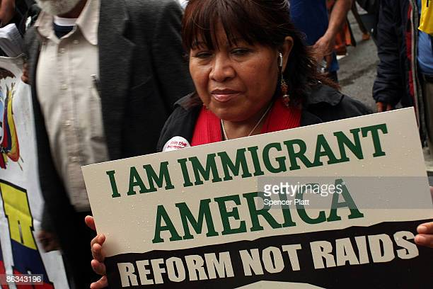 A woman marches with a pro immigration sign during a rally for immigrant worker rights and for social justice on May Day May 1 2009 in New York City...