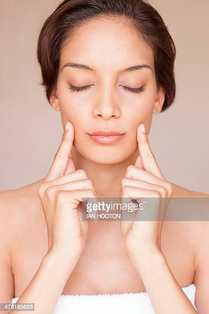 Woman massaging her face