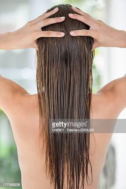 Woman massaging her hair