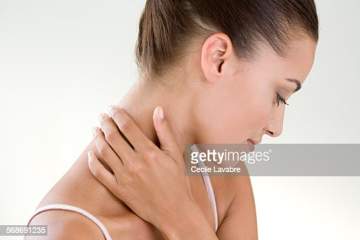 Woman massaging her nape