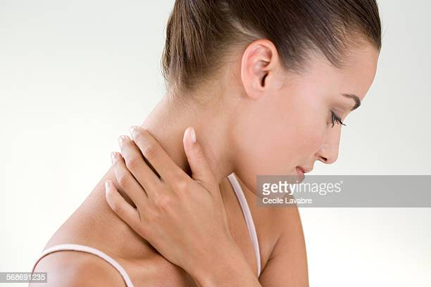 Woman massaging her nape