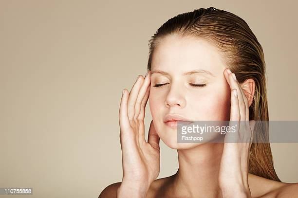 Woman massaging her temples
