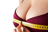 woman measured her huge breast with a measuring tape