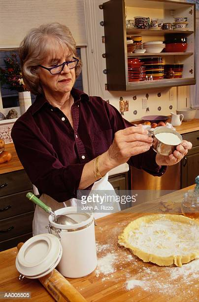 Woman Measuring Flour in the Kitchen