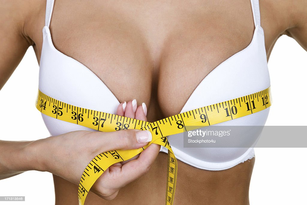 Woman measuring her breast : Stock Photo