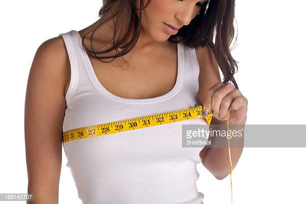 Woman measuring her chest
