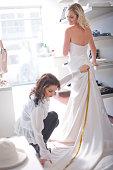 Woman measuring train of wedding dress