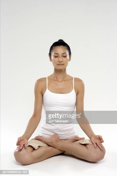 Woman meditating, eyes closed, close-up