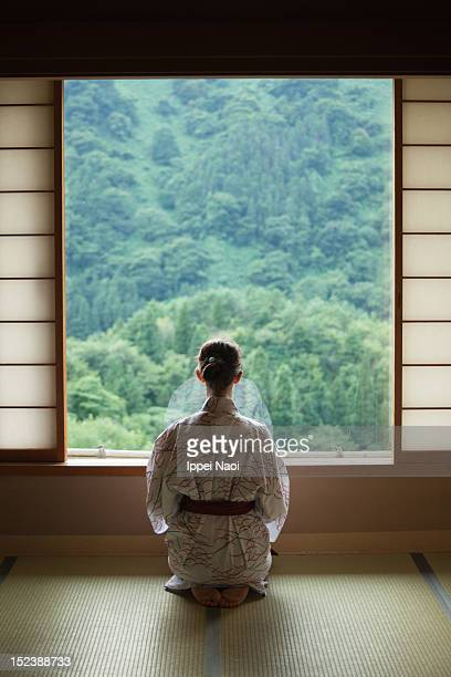 Woman meditating in Japanese room