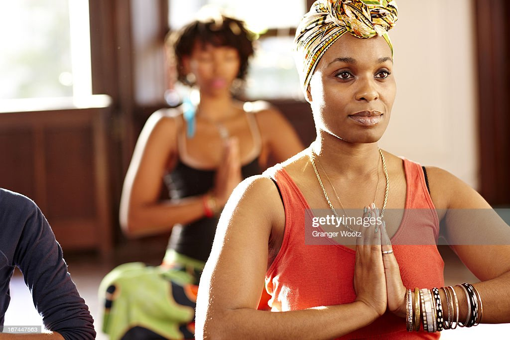 Woman meditating in yoga class : Stock Photo