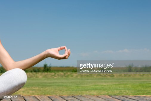 Woman meditating outdoors, cropped view : Foto de stock