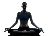 one caucasian woman exercising yoga meditating in silhouette studio   on white background