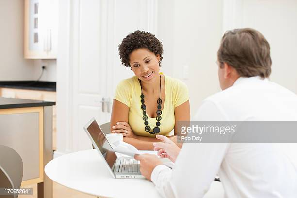 Woman meeting with financial advisor