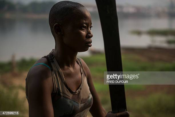 A woman member a group of women presenting themselves as antibalaka and 'Amazons' protecting their island from the members of the exSeleka poses with...