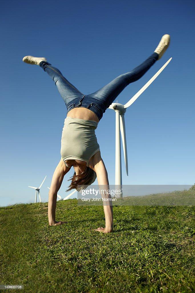 woman mimicking wind turbines : Stock Photo