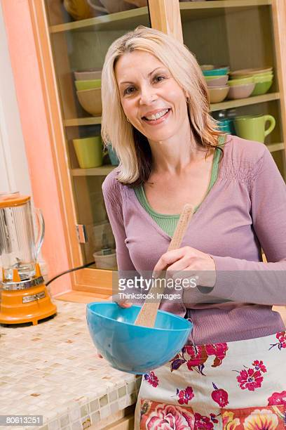 Woman mixing in kitchen