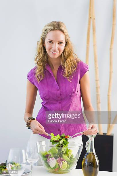 Woman mixing salad in a bowl