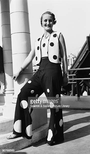 Woman modelling a polka dot trouser suit c 1930s A collection of photographs equipment and printed material tracing the history of photography...