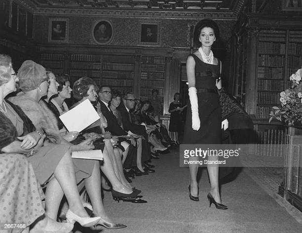 A woman models a dress for an audience at a Christian Dior couture show at Longleat