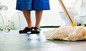 Woman mopping bathroom floor
