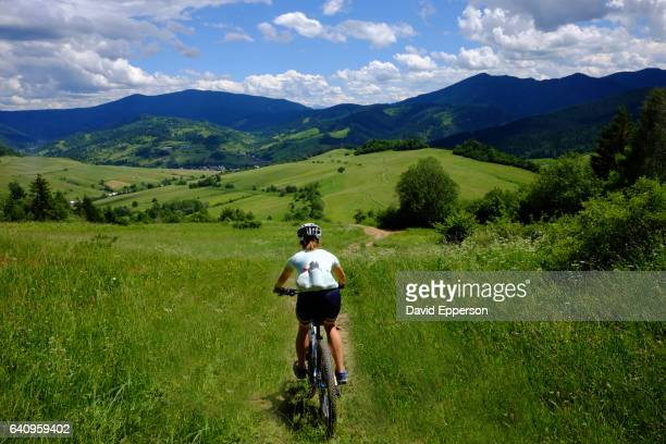 Woman mountain biking in Mala Fatras mountains of Slovakia